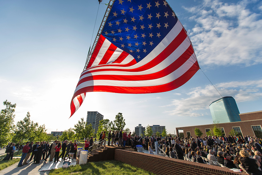 The crowd files in under a giant American flag at the dedication of the George W. Bush presidential library on the campus of Southern Methodist University in Dallas.