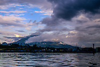 Indonesia, Sulawesi, Manado. Manado harbour with Mount Klabat in the background.