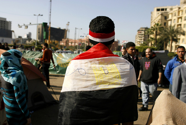 Egyptian protesters take part in a demonstration at the Tahrir square in Cairo, Egypt, Thuresday, March 3, 2011. hundreds of protesters are camping at the Tahrir square in an ongoing campaign demanding the resignation of the current Egyptian government headed by prime minister Ahmed Shafiq. Photo by Wissam Nassar