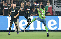 LOS ANGELES, CA - OCTOBER 29: Latif Blessing #7 of Los Angeles FC passes a ball past Joevin Jones #33 of the Seattle Sounders FC during a game between Seattle Sounders FC and Los Angeles FC at Banc of California Stadium on October 29, 2019 in Los Angeles, California.