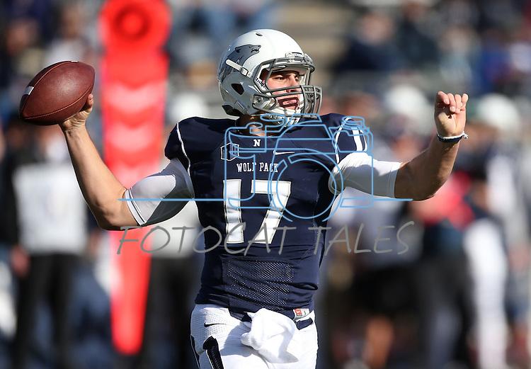 Nevada quarterback Cody Fajardo (17) competes against BYU in an NCAA college football game in Reno, Nev., on Saturday, Nov. 30, 2013. (AP Photo/Cathleen Allison)