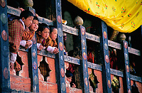 Asia, Buthan, Paro Dzong,children at balcony looking for the Paro-tThetchu festival
