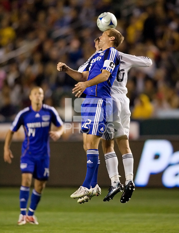Kansas City Wizards defender Jimmy Conrad (12) battles in the air with LA Galaxy midfielder Ely Allen (26) during a MLS match. The LA Galaxy defeated the Kansas City Wizards 3-1 at Home Depot Center stadium in Carson, Calif., on Saturday, May 24, 2008.
