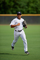 GCL Yankees East center fielder Robert Javier (19) jogs back to the dugout during the first game of a doubleheader against the GCL Blue Jays on July 24, 2017 at the Yankees Minor League Complex in Tampa, Florida.  GCL Blue Jays defeated the GCL Yankees East 6-3 in a game that originally started on July 8th.  (Mike Janes/Four Seam Images)