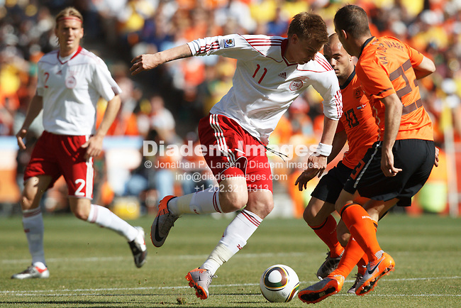 JOHANNESBURG, SOUTH AFRICA - JUNE 14:  Nicklas Bendtner of Denmark (11) in action against the Netherlands during the FIFA World Cup Group E match at Soccer City Stadium on June 14, 2010 in Johannesburg, South Africa.  Editorial use only.  Commercial use prohibited.  No push to mobile device usage.  (Photograph by Jonathan P. Larsen)