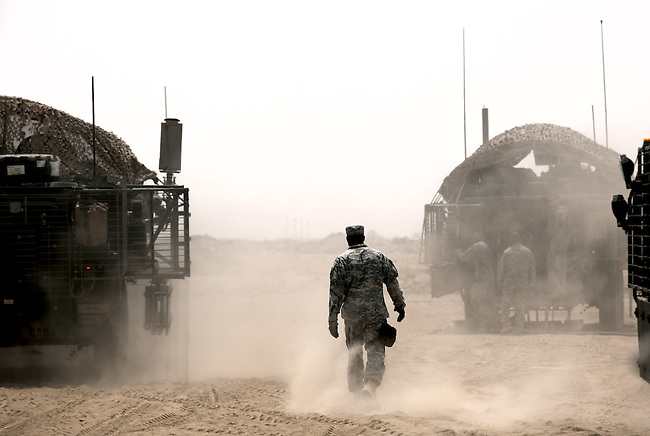 SOUTHERN IRAQ 18 AUGUST 2010:  A soldier of the 4/2 Strykers Brigade follows his vehicle through the endless dust as his convoy takes a breather en-route to the Kuwait border where they will be packing up and heading back to the USA.  Iraq is preparing after US President Barack Obama has confirmed the end of all combat operations in the country by 31 August..Some 50,000 of 65,000 US troops currently in Iraq are set to remain until the end of 2011 to advise Iraqi forces and protect US interests.The remaining 50,000 troops will stay in the country in order to train Iraqi security forces, conduct counterterrorism operations and provide civilians with ongoing security, said Mr Obama..An agreement negotiated with the Iraqis in 2008 states that these troops must be gone from the country by the end of next year. pic Graham Crouch/The Guardian