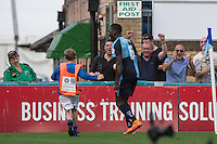 A young ballboy runs to celebrate with injury time goal scorer Aaron Pierre of Wycombe Wanderers during the Sky Bet League 2 match between Wycombe Wanderers and Dagenham and Redbridge at Adams Park, High Wycombe, England on 22 August 2015. Photo by Andy Rowland.