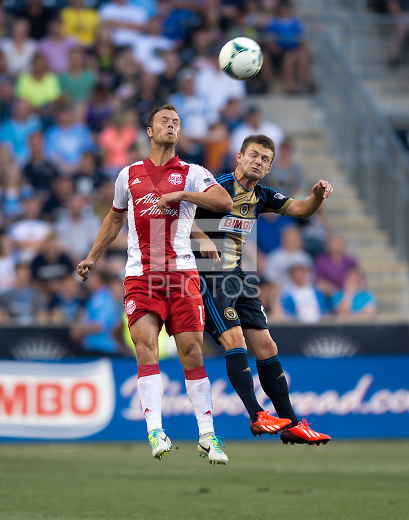 Jack McInerney (9) of the Philadelphia Union goes up for a header with Jack Jewsbury (13) of the Portland Timbers during a Major League Soccer game at PPL Park in Chester, PA.  Philadelphia Union tied the Portland Timbers, 0-0.