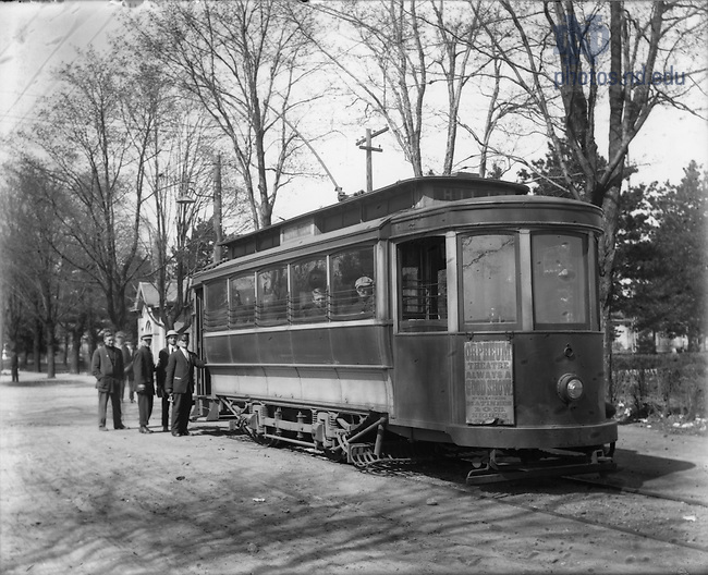 GGPP 1/06:  Students waiting for a streetcar on campus along Notre Dame Avenue, c1890s.  The post office is in the background.  Image from the University of Notre Dame Archives.