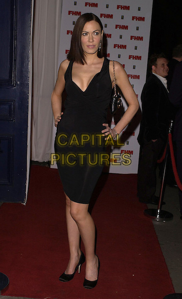 LINZI STOPPARD.The FHM 100 Sexiest Women In The World Party 2006 at Madame Tussauds, London, UK. .May 3rd, 2006.Ref: CAN.full length black dress .www.capitalpictures.com.sales@capitalpictures.com.©Capital Pictures