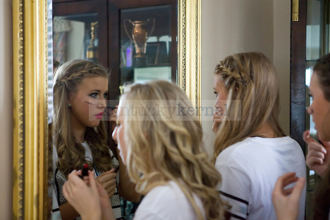 Members Kappa Alpha Theta apply makeup before Greek Sing in Lexington, Ky., on Saturday February 8, 2014. Photo by Emily Wuetcher | Staff