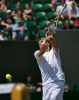 England, London, 28.06.2014. Tennis, Wimbledon, AELTC,  Paul Haarhuis (NED) returns the ball with the grip of his racket<br /> Photo: Tennisimages/Henk Koster