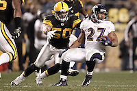 PITTSBURGH, PA - NOVEMBER 06:  Ray Rice #27 of the Baltimore Ravens runs with the ball while evading a tackle by Larry Foote #50 of the Pittsburgh Steelers during the game on November 6, 2011 at Heinz Field in Pittsburgh, Pennsylvania.  (Photo by Jared Wickerham/Getty Images)