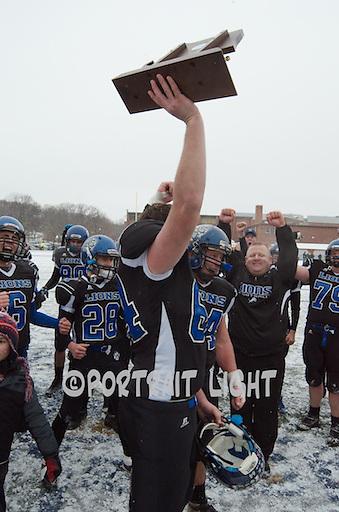 WBHS senior captain Tyler O'Day holds the Division 5 Super Bowl trophy aloft.