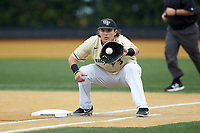 Wake Forest Demon Deacons first baseman Bobby Seymour (3) fields a throw for a putout during the game against the Miami Hurricanes at David F. Couch Ballpark on May 11, 2019 in  Winston-Salem, North Carolina. The Hurricanes defeated the Demon Deacons 8-4. (Brian Westerholt/Four Seam Images)