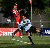 Sandy Sanchez (1) of Cuba collides with Jorman Aguilar (18) of Panama  after a save during the group stage of the CONCACAF Men's Under 17 Championship at Jarrett Park in Montego Bay, Jamaica. Panama tied Cuba, 0-0.