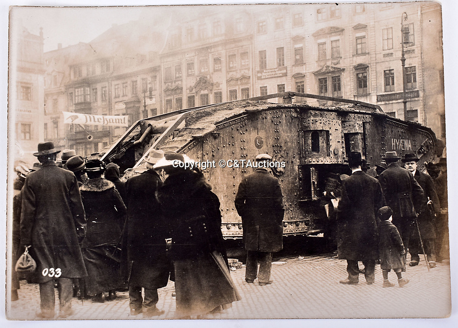 Bmth News (01202 558833)<br /> Picture:  C&TAuctions/BNPS<br /> <br /> Captured British tank 'Hyaena', on display in Leipzig as part of a war booty exhibition, 1918.<br /> <br /> Remarkable photographs revealing how the Germans used captured British tanks against us because theirs were no good have come to light over 100 years later.<br /> <br /> The British were the first to invent the tank in 1916 and a year later used them to overwhelm the enemy at the Battle of Cambrai in the First World War.<br /> <br /> Although the battle was a success for the British, the Germans captured several Mark IV tanks.<br /> <br /> Now black and white photos have emerged to show the German high command inspecting one the hulking machines in Berlin in 1918.<br /> <br /> Other pictures in the album depicts the early days of aerial warfare when hand grenades were dropped over the side of the cockpits by German pilots.