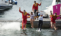 11.08.2012. Weymouth, Dorset, England.  Members of The Spanish team Celebrate by jumoing into the harbour water After Winning in Elliott 6m  Competition of sailing Event London 2012 Olympic Games The Spanish team Won Gold Medal