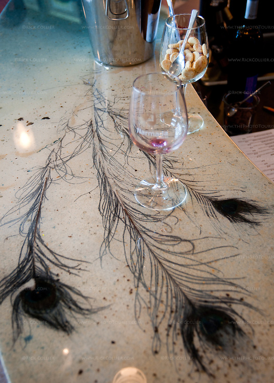 Narmada Winery's tasting bar features peacock feathers set into the acrylic bar top.