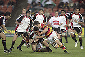 Male Sa'u is taken to ground by Stephen Donald & Steven Bates during the Air NZ Cup week 5 game between Waikato & Counties Manukau played at Rugby Park, Hamilton on 26th of August 2006.