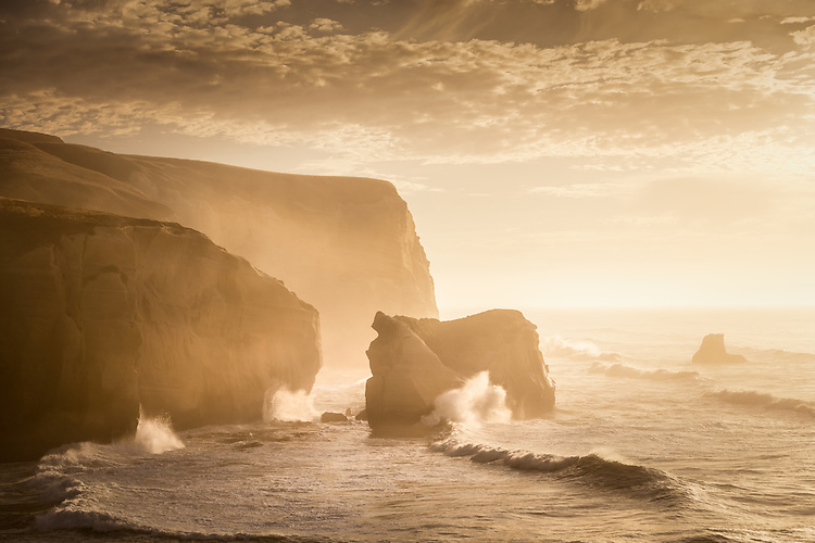Huge southerly waves crash on the cliffs at Tunnel Beach New Zealand - stock photo, canvas, fine art print