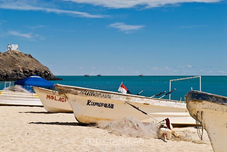 Fishing boats sit on sandy beach at Sea of Cortez, San Felipe, Baja California, Mexico