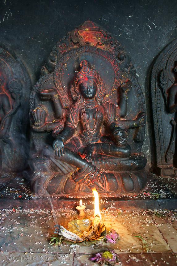 shrine in Vasundhara Mandir, a temple for incarnations of goddess Lakshmi, Annapurna, called Vasudhara, godddess of earth, fruits of earth and wealth in buddhist temple Swayambhu in Kathmandu, Nepal, September 2011