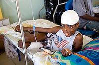The devastation after the earthquake of January 12, 2010. Children being treated at St. Damien's Hospital. Boy with injuries. 2/8/10