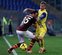 Calcio, Serie A: Roma vs ChievoVerona. Roma, stadio Olimpico, 31 ottobre 2013.<br /> AS Roma defender Vasilis Torosidis, of Greece, and ChievoVerona midfielder Luca Rigoni fight for the ball during the Italian Serie A football match between AS Roma and ChievoVerona at Rome's Olympic stadium, 31 October 2013.<br /> UPDATE IMAGES PRESS/Isabella Bonotto