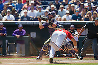 TCU Horned Frogs catcher Evan Skoug (9) waits for a throw at the plate as Texas Tech Red Raiders baserunner Tanner Gardner (8) slides safely home during Game 3 of the NCAA College World Series on June 19, 2016 at TD Ameritrade Park in Omaha, Nebraska. TCU defeated Texas Tech 5-3. (Andrew Woolley/Four Seam Images)