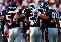 Chicago Bears defensive players #54 Ricardo McDonald, #23 Marty Carter and #97 Mike Wells walk off Soldiers Field in Chicago, Il. after giving up Jacksonville Jaguars' winning touchdown.
