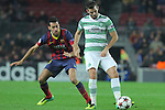 11.12.2013 Barcelona, Spain. UEFA Champions League, Group H Matchday 6. Picture show Sergio Busquets  (L) and Joe Ledley (R)  in action during game between FC Barcelona Against Celtic at Camp Nou