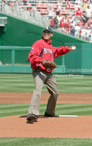 United States President Barack Obama throws out the first pitch at the Washingon Nationals home opener, Washington, DC, Monday, April 5, 2010, to mark the 100th anniversary of the presidential tradition. William Howard Taft was the first president to do so in 1910. .Credit: Martin H. Simon / Pool via CNP