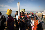 The Queen's Baton spent its last full day in Mozambique on 6 May, 2017, where it visited various locations in Boane, the neighbouring district to the capital city of Maputo.. This Queen's Baton Relay will visit all 70 nations and territories of the Commonwealth, over 388 days and cover 230,000km. It will be the longest Relay in Commonwealth Games history, finishing at the Opening Ceremony on the Gold Coast on 4th April 2018. Photograph shows a local man with the Baton as passengers disembark from a cross-river ferry at Ponte Cais de Maputo.