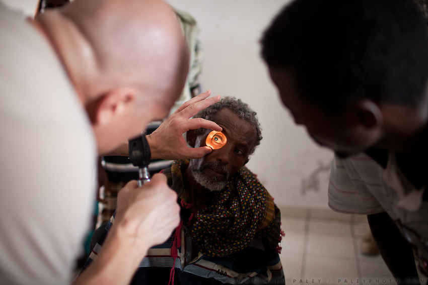 "Eye clinic...Military people from the Civil Affairs department of the US Army doing a trip to Sagallou (near Tadjoura), as part of a medical camp mission. Part of the ""3D approach"" of the US Army : Development (in that case), Democracy, Defense...The geostrategical and geopolitical importance of the Republic of Djibouti, located on the Horn of Africa, by the Red Sea and the Gulf of Aden, and bordered by Eritrea, Ethiopia and Somalia."
