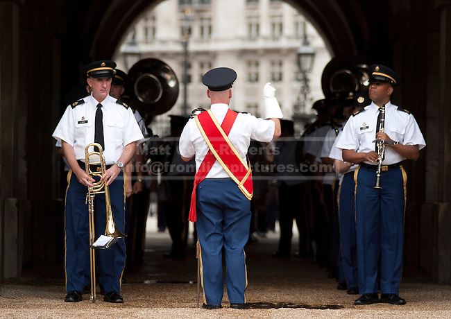 LONDON, UK.  06/06/11. Members of the US Army Europe Band wait for the signal to march onto the parade ground before rehearsals with British counterparts. The United States Army Band join with the Massed Bands and Corps of Drums of the Household Division to rehearse Beat Retreat at Horse Guards Parade. The event takes place on 8th and 9th June for featuring the US band the first time. The US visit comes two weeks after the State visit to London of the US President.