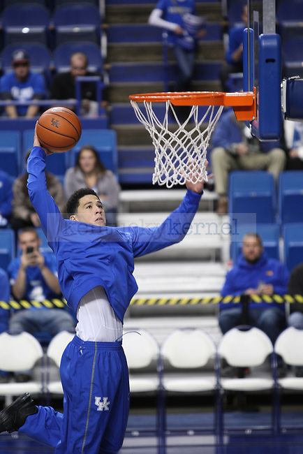 Devin Booker (1) goes up for a dunk during warm ups before the UK men's basketball game vs. Boston University at Rupp Arena. UK leads BU (  ).Friday, November 21, 2014 in Lexington. Photo by Joel Repoley | Staff