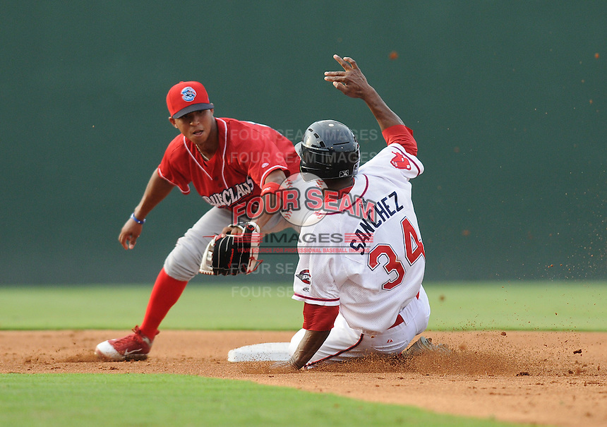 Shortstop Edgar Duran (19) of the Lakewood BlueClaws takes the throw as Felix Sanchez (34) of the Greenville Drive slides safely into second for a stolen base in a game on July 13, 2011, at Fluor Field at the West End in Greenville, South Carolina. (Tom Priddy/Four Seam Images)