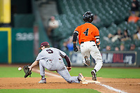 Darien Simms (4) of the Sam Houston State Bearkats appears to have crossed the bag before Tanner Allen (5) of the Mississippi State Bulldogs fields the throw in game eight of the 2018 Shriners Hospitals for Children College Classic at Minute Maid Park on March 3, 2018 in Houston, Texas.  Simms was called out on the play.  (Brian Westerholt/Four Seam Images)