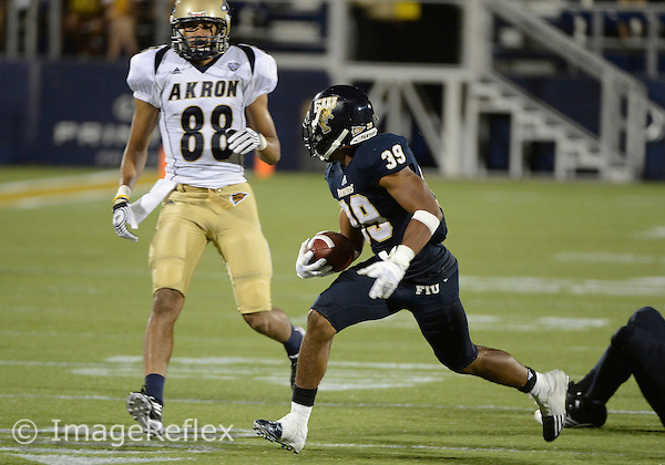 Florida International University football player defensive back Sam Miller (39)  plays against the University of Akron on September 8, 2012 at Miami, Florida. FIU won the game 41-38 in overtime. .