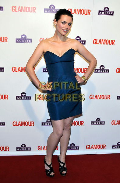 KATIE McGRATH .Glamour Women of The Year Awards 2009, Berkeley Square Gardens, London, England, June 2nd 2009..full length strapless blue dress hands on hips black sandals open toe pockets gold bracelet.CAP/PL.©Phil Loftus/Capital Pictures