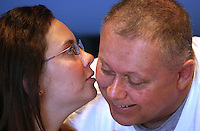 Elizabeth plants a kiss on the cheek of her father, Mike, in her final days at Blank Children's Hospital before being discharged to a brain injury rehabilitation center.