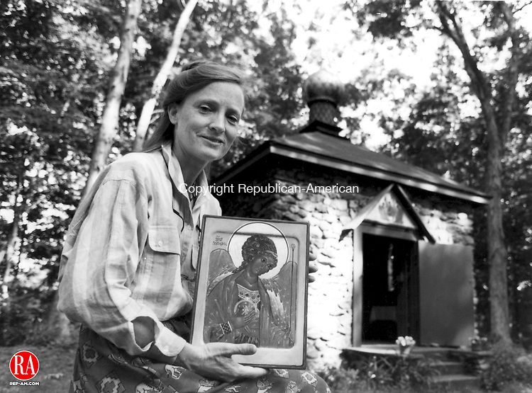 """This 1995 photo depicts Mieke Crider, artist and Russian Village resident, holding one of her works """"Archangel Michael""""."""