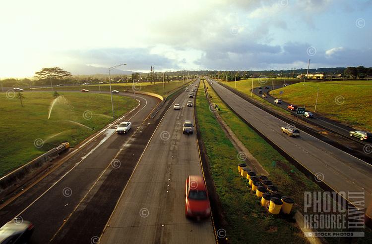 Cars at dusk on H2 freeway near Mililani, Central oahu