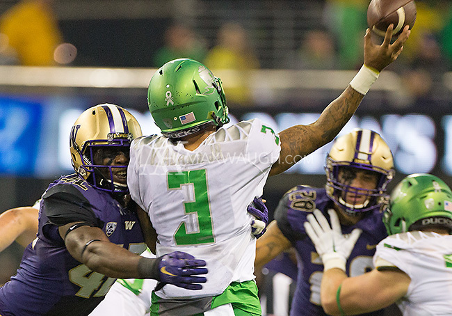 The Huskies couldn't quite get to Vernon Adams quickly enough.  Adams completed this pass under duress from Corey Littleton.