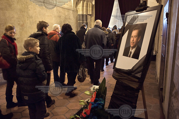 Mourners line up to pay their respects in front of the coffin of Vaclav Havel in the Vladislave Hall of Prague Castle. Havel was a playwright, essayist and poet who became active as a dissident after the Soviet Invasion of Czechoslovakia and ended up being the last president of united Czechoslovakia and the first president of the independent Czech Republic. He died on 18 December 2011 at the age of 75..