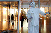 A living statue at the Anne Cox Chambers Wing of the High Museum of Art. Over the next three years, the High Museum will feature hundreds of works of art from the Musée de Louvre.