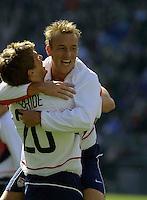 Brian McBride, left, Clint Mathis, right, Honduras vs USA, 2002.