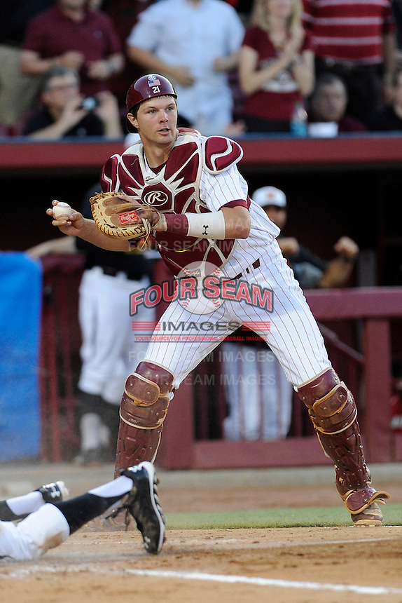 Catcher Grayson Greiner (21) of the South Carolina Gamecocks looks for a play in an NCAA Division I Baseball Regional Tournament game against the Maryland Terrapins on Sunday, June 1, 2014, at Carolina Stadium in Columbia, South Carolina. Maryland won, 10-1, to win the tournament. (Tom Priddy/Four Seam Images)