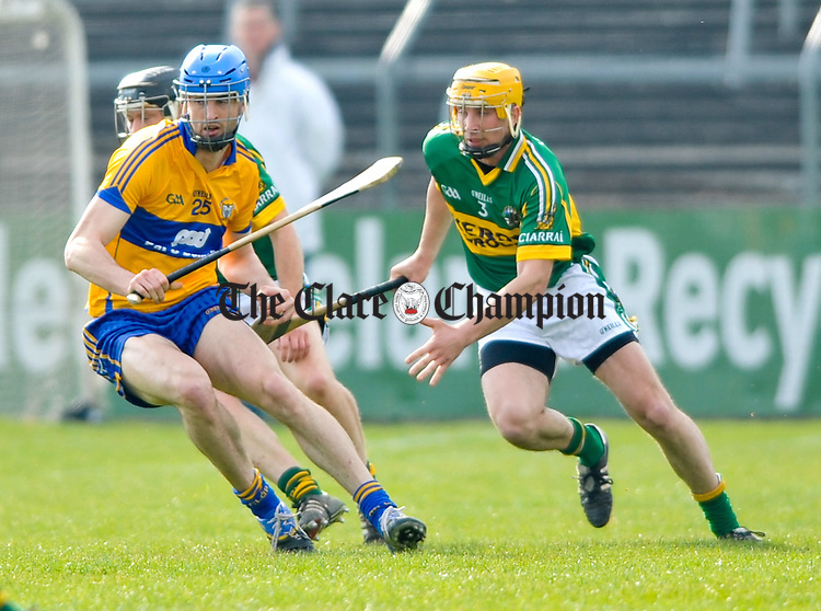 Darach Honan of Clare in action against Tom Murnane of Kerry during their National hurling league game at Cusack Park, Ennis. Photograph by John Kelly.